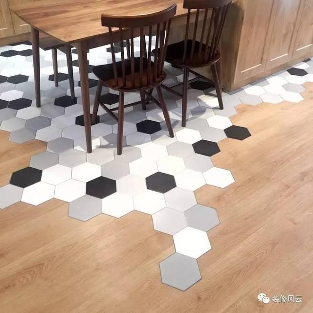 瓷砖铺好过后,就可以开始贴地板了,在接缝处,工人师傅现场切割地板