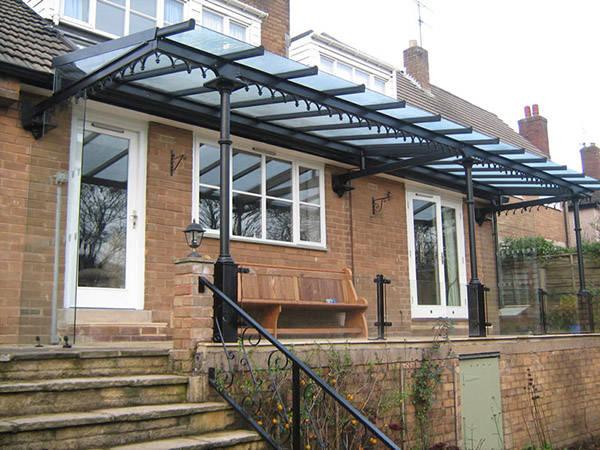 钢结构雨棚计算_钢结构玻璃雨棚的材料比较