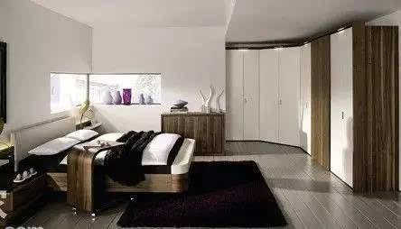 开间 卧室衣柜装修效果图方案分析:拐角形的衣柜,衣柜能够承担隔断墙