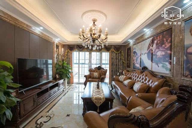 客厅 棕皮的沙发大气时尚,光泽的质感与大理石的墙面提升空间质感