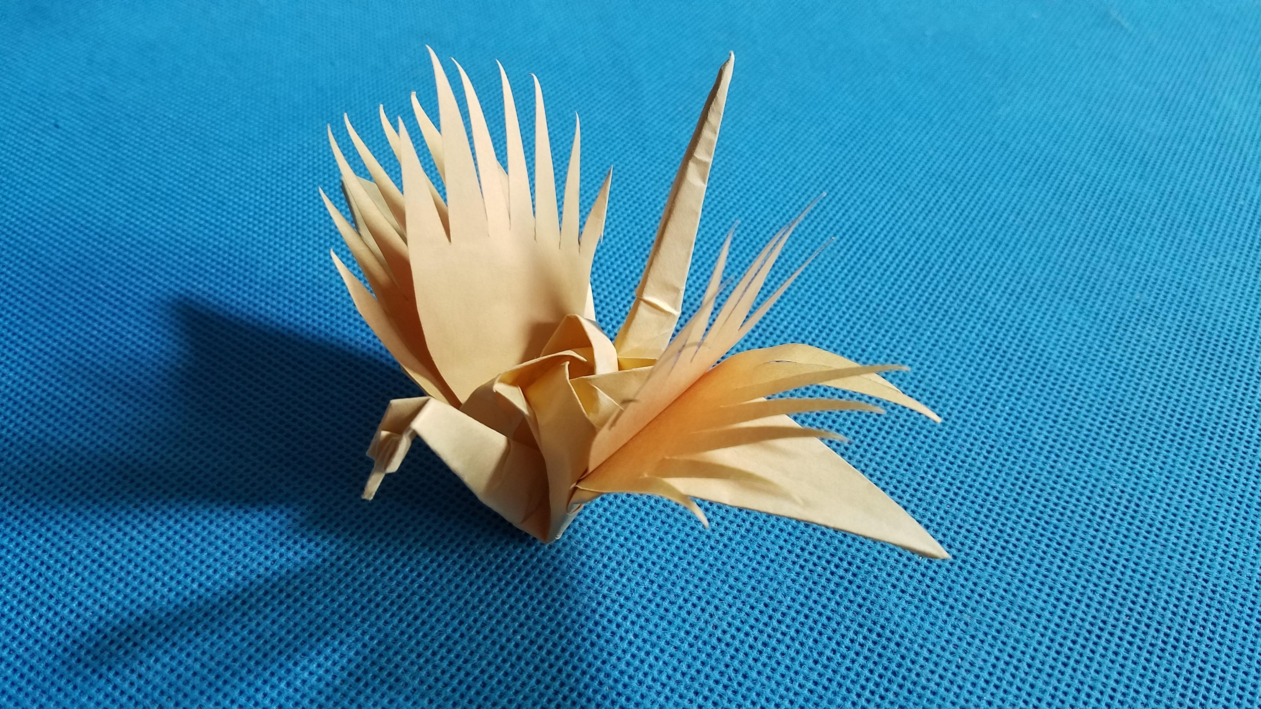 择天记寻风鹤的折法其实就是折纸玫瑰千纸鹤的基础上加了一些剪开的