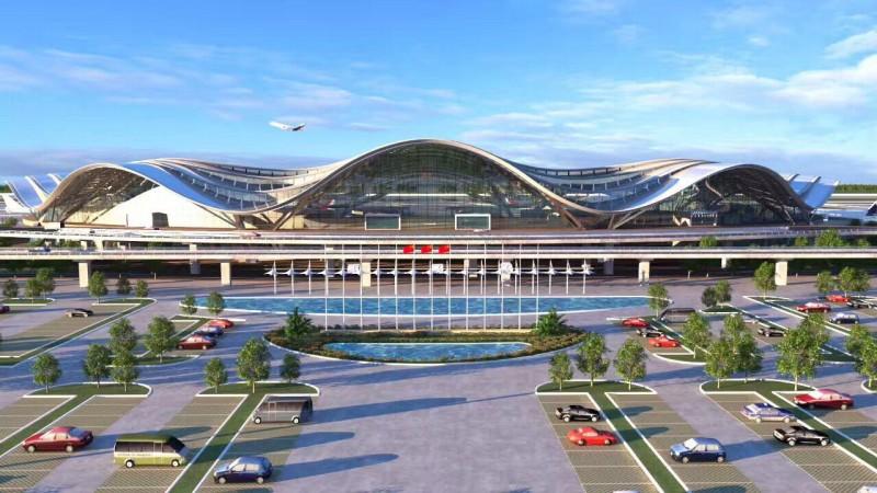 最后一榀长18米,重28吨的钢柱被缓缓吊起,嵌入钢架里,桂林两江机场t2图片