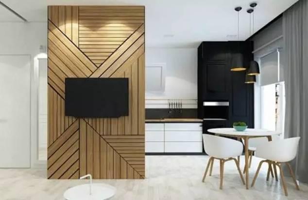 镶嵌式电视墙使两物处于同一平面,整体更加统一及简约,还可避免电视落图片