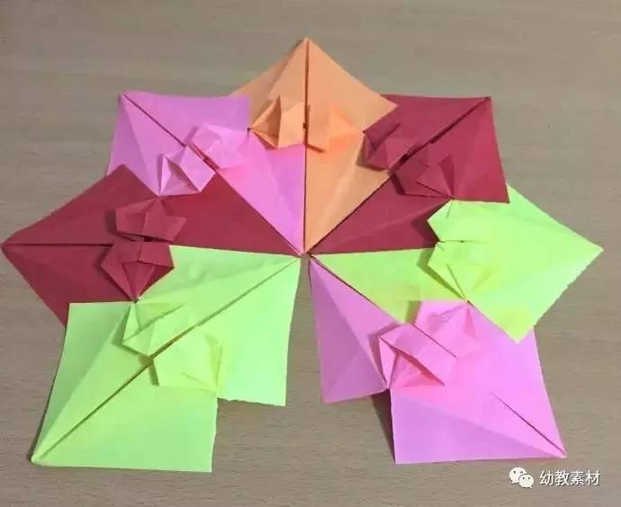母婴 正文  制作材料: 7张等大的正方形彩纸,制作伞把的材料可选择(铁