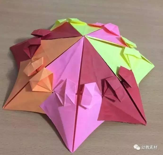 母婴 正文  制作材料: 7张等大的正方形彩纸,制作伞把的材料可选择