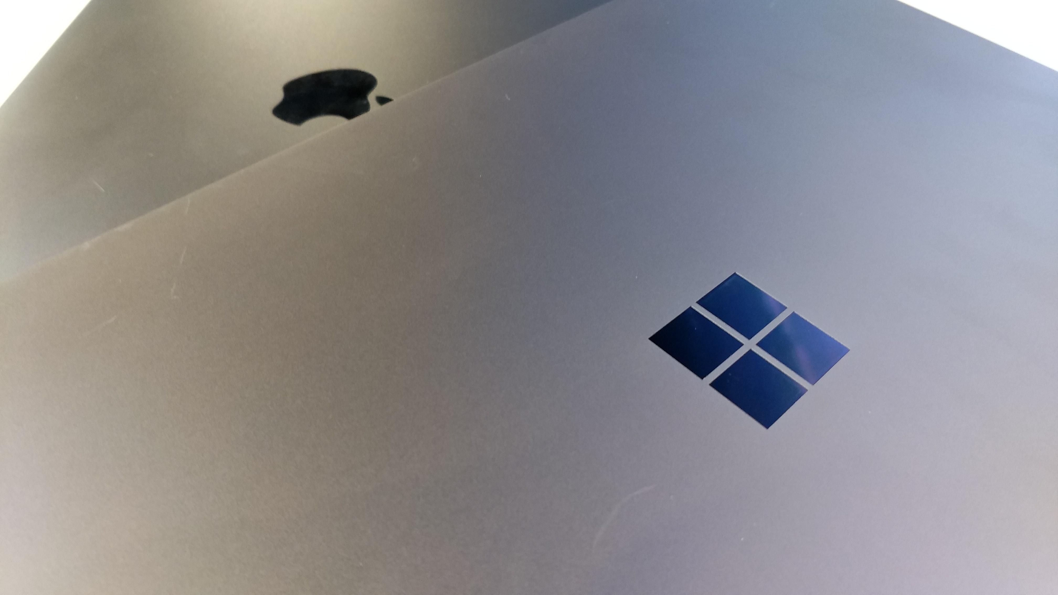 微软Laptop对比苹果新款MacBook,你会选择谁?的照片 - 1